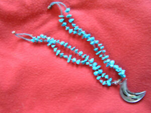 993. Real Turquoise necklace with blown glass composite moon. Length is 10 in an