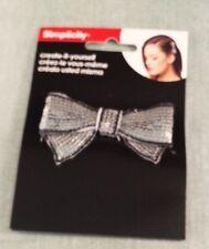 Simplicity silver sequin bow w/black trim headband accent