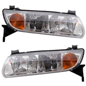 Headlights Set fits 2000-2002 Saturn L-Series Pair Headlamps w/ Housing Assembly