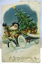 1908 POSTCARD MERRY CHRISTMAS, SANTA CLAUS DRIVING CAR WITH TREE & TOYS