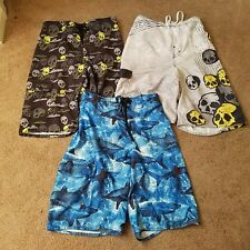 Lot of 3 pairs of boys swim shorts, size L skulls, and sharks
