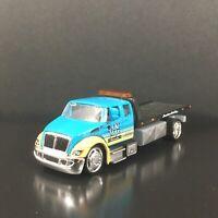 INTERNATIONAL DURASTAR FLATBED TOW TRUCK RARE 1/64 SCALE DIECAST MODEL CAR