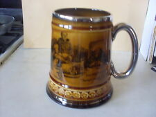 Ridgways Pottery Mug with silver coloured rim and handle.