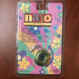 Nano Baby (Green) 1997 New In Box Vintage 1997 Playmates Virtual Pet Tamagotchi