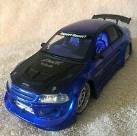 JADA 1/24 IMPORT RACER  MITSUBISHI MOTORS LANCER EVOLUTION VI METALLIC BLUE VHTF
