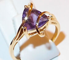 Amethyst solitaire with looping bands, 14K gold overlay Sterling Silver, Size R.