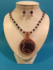 Large Amethyst pendant wire wrapped  & hung on a beaded necklace with earrings.