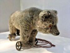 Antique Bing Works Teddy Bear on iron wheels C1907