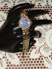 CHEROKEE WOMANS QUARTZ WATCH WITH BLUE FACE WATCH DOES WORK