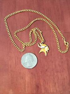 Minnesota Vikings Team Logo Pendant With Gold tone necklace.