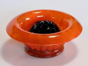 Mid-century Davidson orange cloud glass bowl and black flower frog