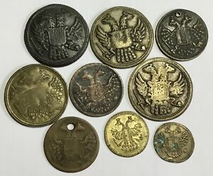 COLLECTION OF QUEEN VICTORIA  DOUBLE HEADED EAGLE BRASS GAMING TOKENS