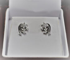.20pt Diamond Flower Swirl Earrings 14kt White Gold