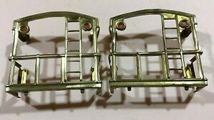 A pair of standard gauge Lionel 517 caboose end railings.