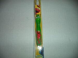 Sesame Street Kids Crest Green And Yellow Elmo Soft Bristle Toothbrush