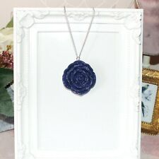 Long silver necklace with large blue rose pendant