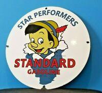 VINTAGE STANDARD GASOLINE PORCELAIN GAS STAR PERFORM WALT DISNEY PINOCCHIO SIGN