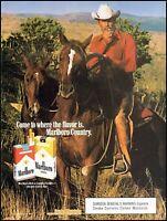 1986 Marlboro man cowboy horseback marlboro cigarettes photo Print Ad ads24