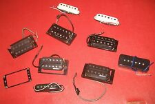 Nine Electric Guitar Pickups. Three Jackson, Two Duncan, Four Unknown Makers.