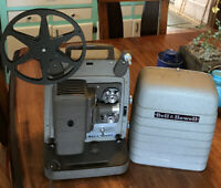 VTG BELL & HOWELL 8MM MOVIE PROJECTOR MODEL 253 AX POWERS UP LIGHTS UP TURNS