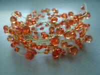 5 METRE ORANGE ACRYLIC CRYSTAL GARLAND ON A GOLD WIRE/WEDDING/VASES