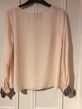 Peach blouse boat neck long sleeve heavily beaded cuffs slits down sleeves 10