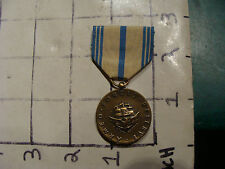 Medal:  ARMED FORCES RESERVE, BUGALS on the back, torch