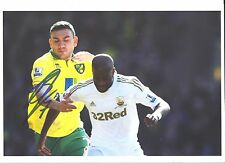 A 12 x 8 inch photo personally signed by Robert Snodgrass of  Norwich City