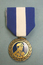 coach award with blue and white pin ribbon
