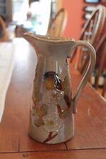 Ceramic Pitcher with raised Blue Bird design Pitcher by Burton & Burton