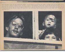 Jessica McClure- atop her mothers shoulders 10/30/87 -AP Laser- Press Photo