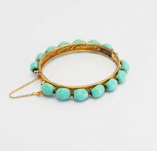 Vintage gold tone metal and blue glass nuggets bracelet by Miriam Haskell