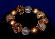 Gold, white and clear beaded bracelet