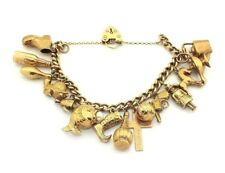 Ladies/womens 9ct gold vintage charm bracelet with 15 charms + padlock fastening