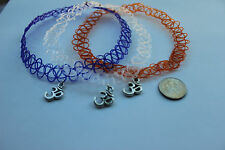 x3 stretchy tattoo chokers:clear,purple,orange necklece+ OM Tibet. silver charm