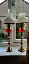 PAIR OF VICTORIAN CRANBERRY AND BRASS OIL LAMPS