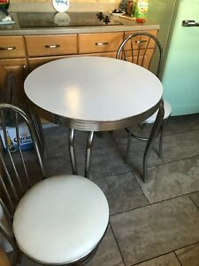 vintage chrome table and two chairs