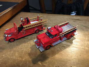 Lot of 2 Hallmark Fire Truck Ornaments (2006 and 2005)