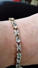 Gold over sterling silver bracelet with  aqua colored stones/ diamond  chips 7.5