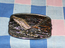 o2. Belt Buckle Eagle Wings Spread Flying Mountains in Background