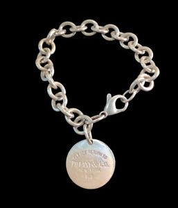 "Genuine Tiffany & Co Sterling Silver ""Return to Tiffany 925"" Round Tag Bracelet."