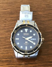 Vintage SEIKO QUARTZ  Date/Day SQ SPORTS 150 Gold Bezel Black Dial Two Tone Band