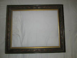 An old carved wooden picture frame