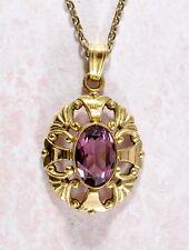 Hermoso Colgante en oro de recargado Vintage con Cristal Violeta/Piedra Amatista?
