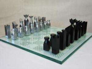 VINTAGE  DESIGN ALUMINUM  CHESS SET ENGLISH  BY A. CARLTON AND ORIG  BOARD