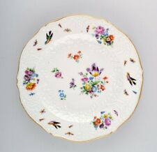 Antique Meissen plate in hand-painted porcelain with flowers and birds. 19th C.