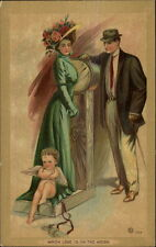 Romance Couple Pretty Woman on Scale Cupid - Gold Border #504 c1910 Postcard