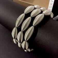 Bracelet Lotus la Mollla / la Molla / Tiziana Redavid / Piano Wire Jewelry
