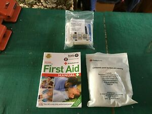 First Aid Manual The Step by Step Guide  by St. John Ambulance+ 2 bandage packs