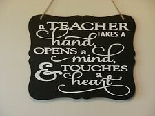 A Teacher takes a hand opens a mind, heart, hanging sign, plaque, vinyl saying